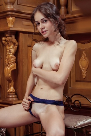 Teen with small sagging tits