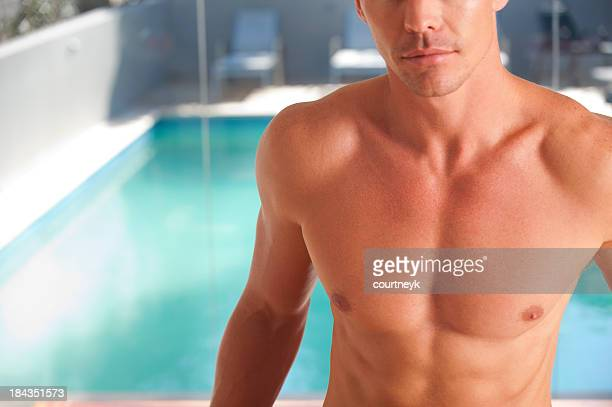 Young man swimming nude